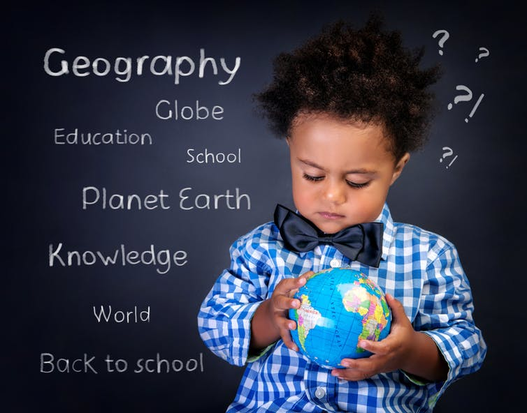 Picture of little colored boy with a globe.